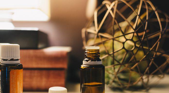 brown semi transparent small bottle half full with CBD oil tincture