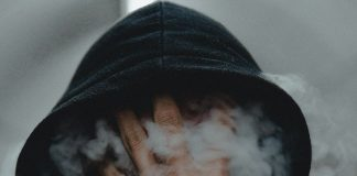 Face filled with smoke from vape or smoke