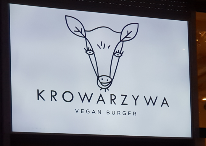 Exterior sign of the vegan restaurant Krowarzywa