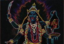 A four armed neon fluorescent Hindu goddess called Kali is holding a sword, a severed head and a dripping bowl
