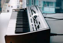 Profile view of synth with wooden side details.