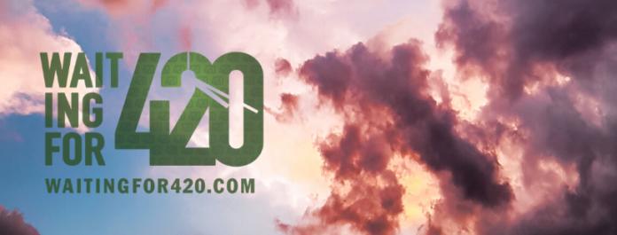 waiitng for 420 dot com logo on a blue sunny sky with a partially clouded sun